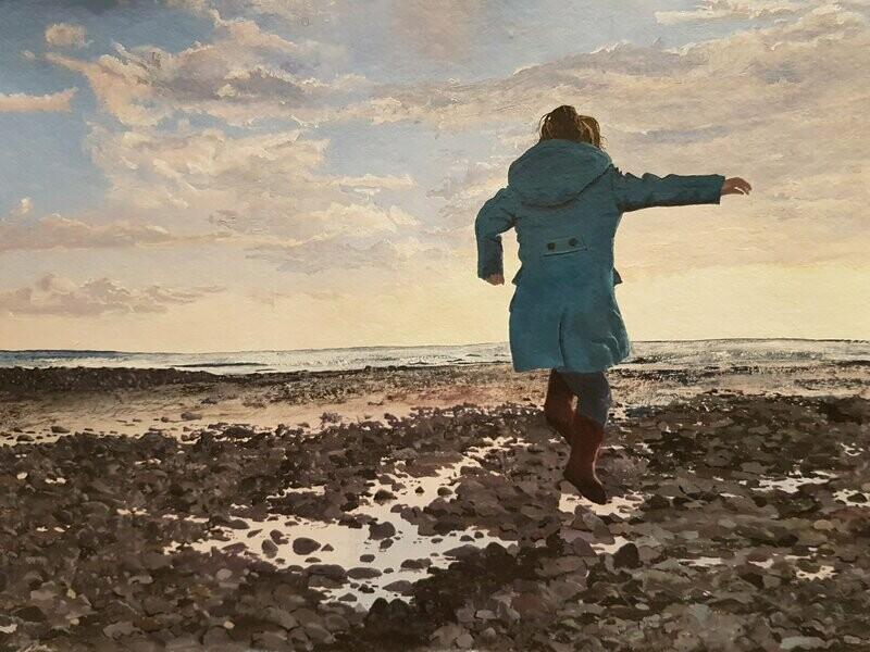A girl jumping over rock pools