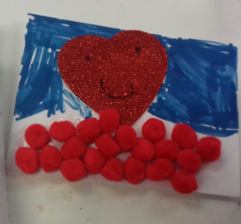 A child's drawing of a red heart with smiley face and a blue felt tip sky