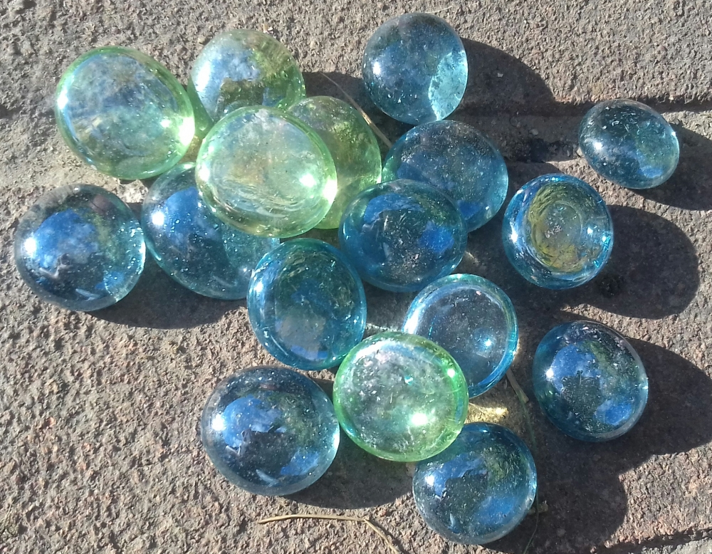 Decorative glass pebbles in blue and green