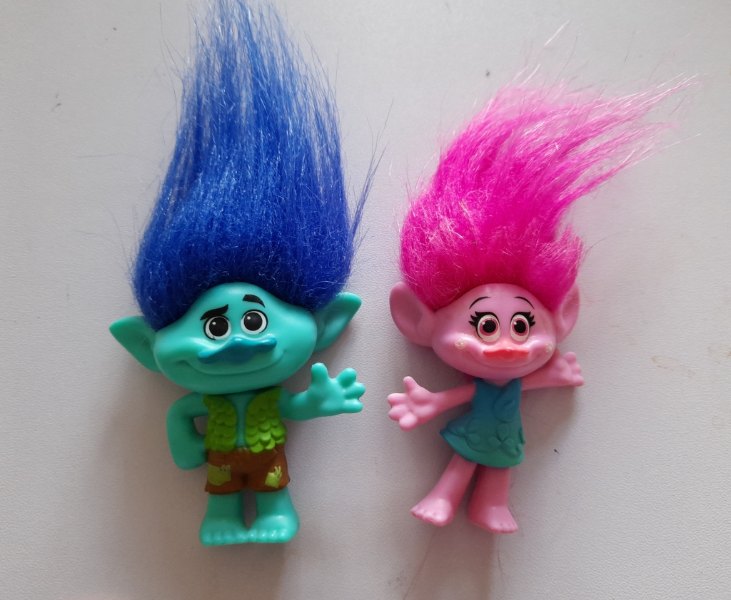 A blue haired boy troll and a pink haired girl troll
