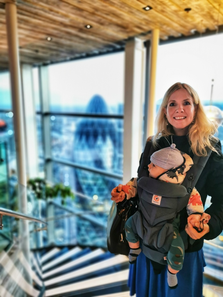 Clare and baby Sonny with the Gherkin building in the background