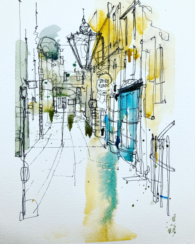 A lantern is the central object in this street scene with glorious hopeful touches of blue and yellow in the scene